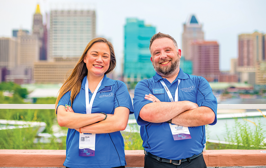 CadmiumCD employees standing back to back upon the Baltimore skyline