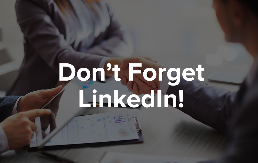 A man makes connections on LinkedIn on his iPad while two others actually meet in person and share documents on a clipboard.