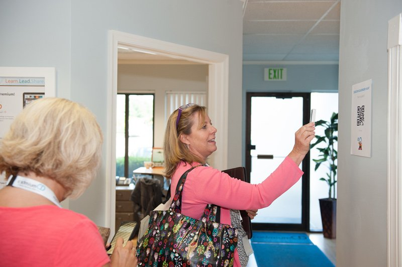 A CadCon attendee scanning a QR code for the CadmiumCD scavenger hunt.